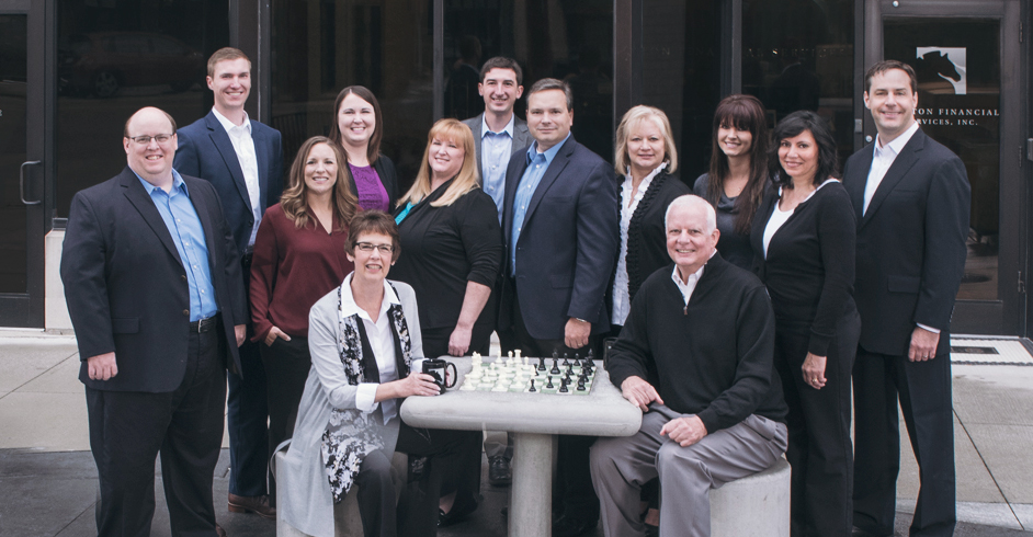 Image of Clayton Wealth Partners Team at Chess Board
