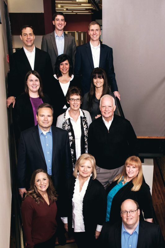 Image of - Clayton Wealth Partners - Team on Stairs