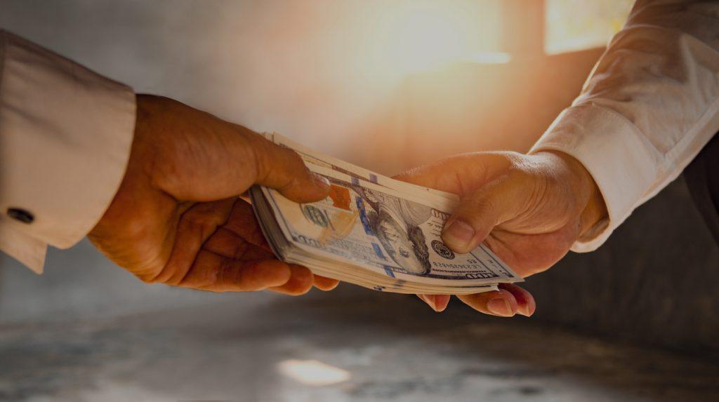 handing cash to someone